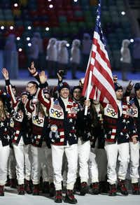 Todd Lodwick of the United States carries the flag as he leads the team during the opening ceremony.Mark Humphrey - AP