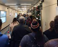 Passengers at Chicago's Midway Airport prepared Sunday to board their Southwest Airlines flight that was supposed to take them to Branson Airport. Pilots instead landed their flight at M. Graham Clark Downtown Airport.