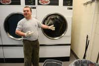 Michael Grimes, a special education student from the Notre Dame School of Dallas, feels the heat from the dryer at the SPCA of Texas on April 8, 2014 in Dallas. The partnership with the SPCA and the school, which serves students ages 8 to 21 with mild to moderate cognitive disabilities, lets students who are interested in a career with animals volunteer at the shelter.ROSE BACA  - neighborsgo staff photographer