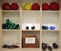 Free weights, medicine balls and other workout equipment sit in wall cubbies at the Edgemere fitness center Wednesday, September 11, 2013 in Dallas. In its 12th year, Edgemere offers retirement and assisted living community options to people 62 years of age and older.