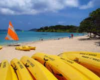 A fleet of bright yellow kayaks is ready for action at Caneel Bay, St. John.