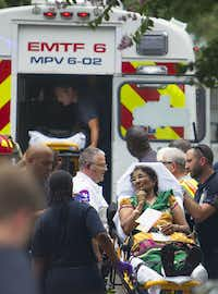Authorities load a woman into a Mass Casualty ambulance after a floor collapsed on Thursday, June 26, 2014, in Katy, Texas.  A floor collapsed under a large crowd of people gathered for a religious event at a home, sending three dozen people to hospitals, though most suffered minor injuries, authorities said. The collapse occurred while as many as 125 people gathered for the event in a residential neighborhood in Katy, just west of Houston. (AP Photo/Houston Chronicle, Cody Duty)Cody Duty - AP