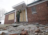 David Luchsinger, superintendent of Statue of Liberty National Monument, and last resident of Liberty Island, poses for a photo at the back door of his Superstorm Sandy-damaged home,on Liberty Island in New York, Friday, Nov. 30, 2012. Tourists in New York will miss out for a while on one of the hallmarks of a visit to New York, seeing the Statue of Liberty up close. Though the statue itself survived Superstorm Sandy intact, damage to buildings and Liberty Island's power and heating systems means the island will remain closed for now, and authorities don't have an estimate on when it will reopen. (AP Photo/Richard Drew)Richard Drew - AP