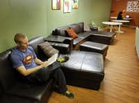 Justin Hershberger, who is in his second week of staying at the Samaritan Inn, was doing some reading in the facility's common room on Tuesday. The McKinney City Council this week approved a zoning change to allow expansion of the Collin County homeless shelter.