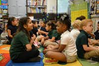 Dulce Cardoso (right) and Caiden Goodnight practice English words in class.Rose Baca - neighborsgo staff photographer