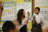Rodríguez asks kindergartener Jaime Torres questions in Spanish during class. On Mondays, Wednesdays and Fridays, the language of the day is Spanish. On Tuesdays and Thursdays, it's English.Photos by ROSE BACA - neighborsgo staff photographer