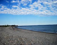On this calm August afternoon, a pebbly stretch of the N.H. shoreline near Seabrook Beach is mirrored by a speckling of clouds.Peter Mandel  -  Special Contributor
