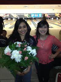 Lupita Rios (right) brought flowers to Esmeralda Cortez as a thank you during the program's senior celebration last year.