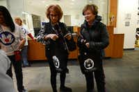 Visitors Nancy Horowitz (left) and Rita Goldberg collect their Shabbat in a Bag at the Jewish Community Center on Dec. 13.ROSE BACA