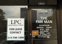 """A """"for lease"""" sign marks the storefront of a shuttered Lakewood business where the Fan Man once kept shop."""