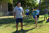 Fifth grade teacher, Manuel Aguirre, coaches soccer player Emmanuel Belmonte at Strickland Intermediate School in Farmers Branch. Aguirre created the team to get students involved in a school activity that would improve their grades and help with behavioral issues.