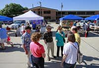 Randy Moore and Norma Moore, center, of Boulder, Colo., talk with friends while visiting the St. Michael's Farmers Market.Ben Torres  -  Special Contributor