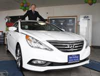 "Bob Stallings, executive chairman of Gainsco Inc., bought a Hyundai dealership off LBJ Freeway in southern Dallas in November, and he wants to add more. ""I want to be a significant dealer,"" he said. ""I love cars."" Bob Stallings stands in the sunroof of a 2014 Sonata SE Hyundai in his new dealership in south Dallas on Wednesday, March 5, 2014. Bob is executive chairman of an insurance-related business and the owner of a racing team, has bought the companyâs first car dealership and plans to purchased 10 more in the future. (David Woo/The Dallas Morning News)David Woo  -  Staff Photographer"