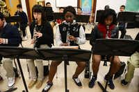 Clarinet players (from left) Andrea Sanchez, Tityana Hashaway and Jada London play their instruments during advanced band class.ROSE BACA/neighborsgo staff photographer