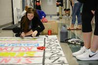 Noelle Anderson works on a poster during leadership class. Creekview High School student council recently received the 2014 National Council of Excellence Award by the National Association of Student Councils. This marks the seventh year in a row the council has been honored with the recognition.Rose Baca - neighborsgo staff photographer