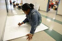 Sydney Franklin, Student Council president, works on a poster during Suzanne Reese's Leadership Class, which include senior members of the Student Council, at Creekview High School in Carrollton. The Student Council recently received the 2014 National Council of Excellence Award by the National Association of Student Councils. This marks the seventh year in a row the council has been honored with the recognition.Rose Baca  -  neighborsgo staff photographer