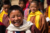 Students cheerfully welcome travelers in Bhutan.Jonathan Look Jr.  -  Special Contributor