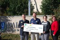Dallas Academy Headmaster Jim Richardson (left) accepts a $30,000 grant from Green Mountain Energy Sun Club   Program Manager, Tony Napolillo along with Dallas Academy Parents Club President Eileen Moore and Treasurer Tena Hargrove on Dec. 17, 2013.Photo submitted by SARAH JAYROE