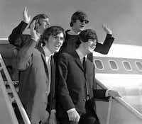The Beatles wave after arriving at the San Francisco airport Aug. 18, 1964, to begin an American tour.