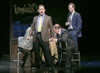 """FILE -- Tom Hanks, center, during a scene in """"Lucky Guy,"""" at the Broadhurst Theater in New York, March 27, 2013. Hanks was nominated for his role in the production which was nominated for best play, for the 67th annual Tony Awards. (Sara Krulwich/The New York Times)"""