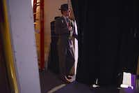 Actor Wes Cantrell watches a scene from backstage during a rehearsal for the concert version of Stephen Sondheim's musical, Follies, at Greater Lewisville Community Theatre. The performance runs Friday through March 16, with proceeds to benefit the theater's live music fund.Rose Baca - neighborsgo staff photographer