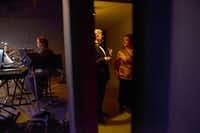 Director Shane Hurst (left) plays the piano while actors Andrew Burns and Kimberly Smith chat after exiting the stage during a rehearsal for the concert version of Stephen Sondheim's musical, Follies, at Greater Lewisville Community Theatre. The performance runs Friday through March 16, with proceeds to benefit the theater's live music fund.Rose Baca - neighborsgo staff photographer