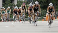 Competitors race down Las Colinas Boulevard during the 40K cycling segment of the Playtri Festival ITU Pan American Race triathlon in Las Colinas on Saturday.