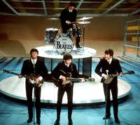 "In this Feb. 9, 1964 file photo, The Beatles perform on CBS' ""Ed Sullivan Show"" in New York. CBS is planning a two-hour special on Feb. 9, 2014, to mark the 50th anniversary of the Beatles' groundbreaking first appearance on the show."
