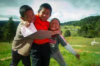Three friends play outside the school in Nichnamtic, Chiapas, Mexico.Jonathan Look Jr.  -  Special Contributor