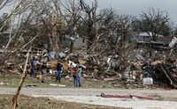 A massive cleanup and recovery effort got under way on Thursday in the Rancho Brazos neighborhood of Granbury, which had 61 homes built by Habitat for Humanity. Of the 64 neighborhood homes built by the nonprofit, every one sustained damage.