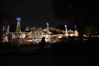 Cars line the street near Joel Occhiuzzo's annual Holiday Express Riding Train in Richardson.ROSE BACA