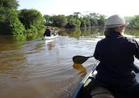 Guests and game rangers paddle the Mzinene River in the Phinda Private Game Reserve.