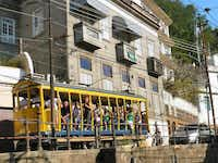 A century-old tram connecting the hilltop neighborhood Santa Teresa with the rest of Rio has operated in much the same way for a hundred years.Colin Barraclough  - Colin Barraclough