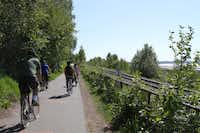This photo taken June 11, 2013, shows people using the Tony Knowles Coastal Trail in downtown, Anchorage, Alaska. Anchorage offers more than 135 miles of multi-use trails in the city.