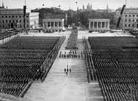 A Nazi rally was held on the Königsplatz in Munich in 1936. The Hitler salute is now illegal.File 1936  -  Bavarian State Library
