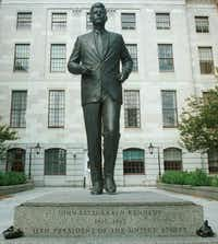 In this Sept. 12, 2000 file photo, a memorial statue of President John F. Kennedy stands on the grounds of the Massachusetts Statehouse in Boston. Three cities loom large in the life and death of John F. Kennedy: Washington, D.C., where he served as U.S. president and as a senator; Dallas, where he died, and Boston, where he was born. With the 50th anniversary of his Nov. 22, 1963 assassination at hand, all three places are worth visiting to learn more about him or to honor his legacy.
