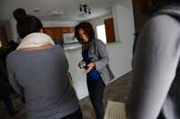 Ethiopia Tuffa welcomes guests inside her family's new Plano home during a dedication ceremony.Rose Baca - neighborsgo staff photographer