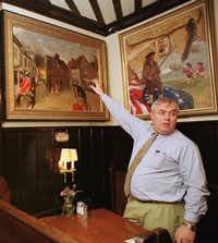 Jim Malinn, general manager of the Union Oyster House, gestures to paintings representing historic moments in Boston's history Wednesday, March 15, 2000, at the Heritage Room of the famous Boston eatery. The building housing the nation's oldest continuously-operating restaurant has served seafood for 174 years, to customers as varied as statesman Daniel Webster, President John F. Kennedy and the 1999 U.S. Ryder Cup team.