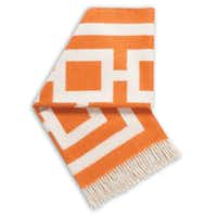 "Throw around some color with Jonathan Adler's graphic alpaca-wool ""Cubes"" blanket. 60 inches square. $295. Nest, 4524 McKinney Ave., Dallas. nestdallas.com."