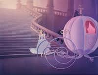 """The wheels of Cinderella's midnight ride inspired the arabesques of York Wallcoverings """"Enchanting"""" wallpaper pattern."""