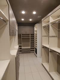 Outdated twin walk-in closets offered only cramped space and limited storage. Johnson removed the wall between, added custom shelving and inset lighting to maximize space and create an illusion of openness.