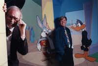 """Animator Chuck Jones, left, and conductor George Daugherty shown with cartoon critters Daffy Duck and Bugs Bunny. Daugherty created """"Warner Bros. Presents Bugs Bunny at the Symphony"""" centered around the """"wascally wabbit"""" and other Looney Tunes cartoon characters, who were drawn by master animator Jones. Jones died in 2002."""