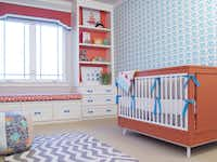 When Erin Sander designed her son's nursery she paid special attention to creating enough storage and added a wall of built ins.