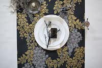 The British company Farrow & Ball suggests scraps of its hand-printed wallpapers, printed with its bespoke paints, has additional uses, such as table runners.