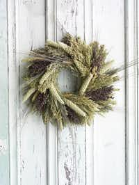 Organic Bouquet's wreath made from pretty, subtle hues from black-bearded wheat, spray millet, canary grass and red sorghum also feeds songbirds.