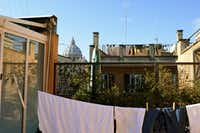 On fine days, Elizabeth Knight dries her laundry on her terrace. In the distance is St. Peter's Basilica.