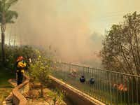 A brush fire burns close to homes in Carlsbad, Calif., on Wednesday, May 14, 2014. (Gina Ferazzi/Los Angeles Times/MCT)Gina Ferazzi - MCT