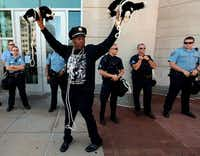 """""""Police have more respect for dogs than they do for black people,"""" activist Anthony Shahid said at a rally Tuesday in Clayton, Mo., using stuffed toys to make his point.Laurie Skrivan - Dispatch"""