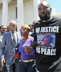 Michael Brown Sr. and Lesley McSpadden, the victim's parents, pleaded for peace Tuesday with the Rev. Al Sharpton, who called for the officer's name.J.B. Forbes - Dispatch