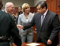 George Zimmerman's defense team congratulated him after he was found not guilty Saturday night in Sanford, Fla.Joe Burbank / Orlando Sentinel